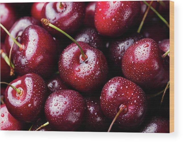 Cherry Wood Print featuring the photograph Fresh Ripe Black Cherries Background by Anna Pustynnikova