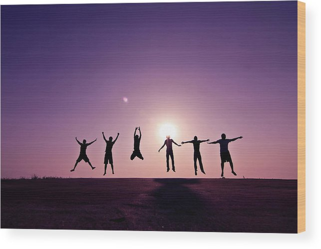 Human Arm Wood Print featuring the photograph Friends Jumping Against Sunset by Kazi Sudipto Photography