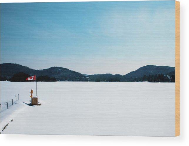 Scenics Wood Print featuring the photograph Frozen Lake In Canada by Haja Rasambainarivo