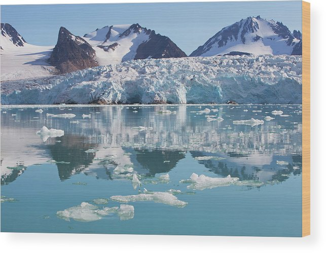Scenics Wood Print featuring the photograph Glaciers Tumble Into The Sea In The by Anna Henly