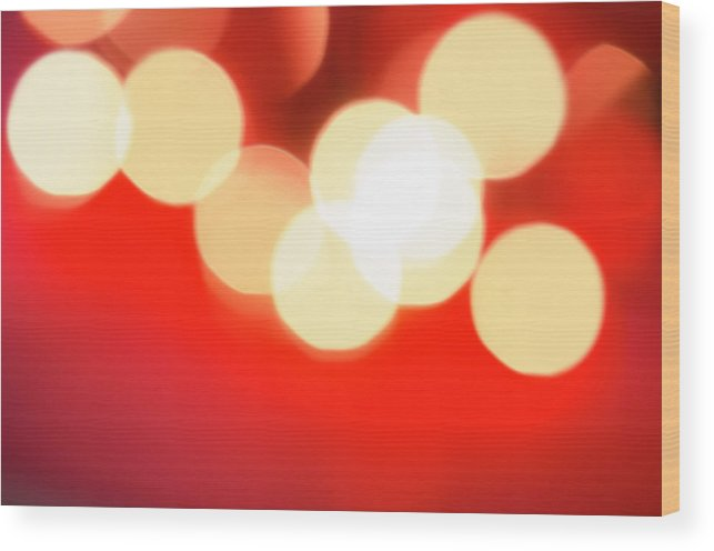 Christmas Lights Wood Print featuring the photograph Glowing Light On Red Background, Studio by Tetra Images