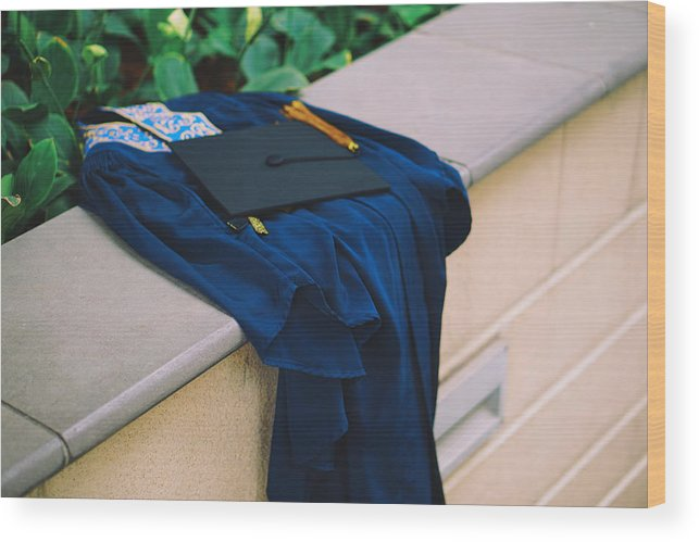 Education Wood Print featuring the photograph Graduation Gown With Mortarboard On Retaining Wall by Danial Najmi / EyeEm