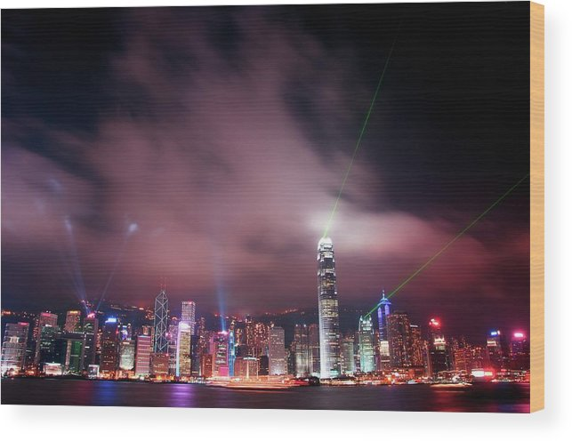 Tranquility Wood Print featuring the photograph Hong Kong Laser Lights by Photo By Dan Goldberger