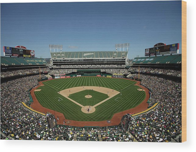American League Baseball Wood Print featuring the photograph Houston Astros V Oakland Athletics by Ezra Shaw