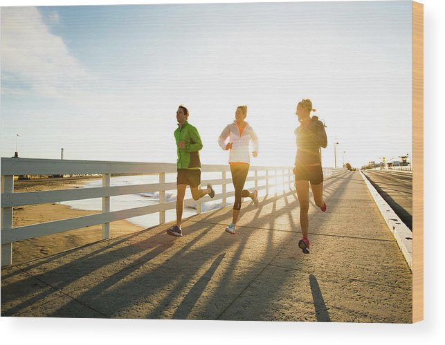 Young Men Wood Print featuring the photograph Jogging Along The Coast by Jordan Siemens