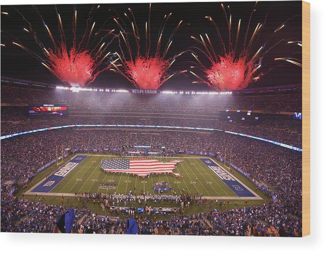 Firework Display Wood Print featuring the photograph Nfl Sep 18 Lions At Giants by Icon Sportswire