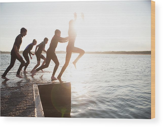Adolescence Wood Print featuring the photograph Pier Jumping by Solstock