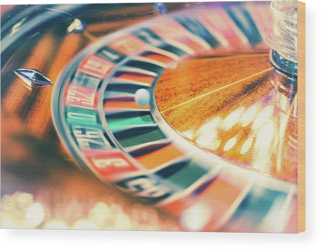 Risk Wood Print featuring the photograph Roulette Wheel In Motion by Deimagine