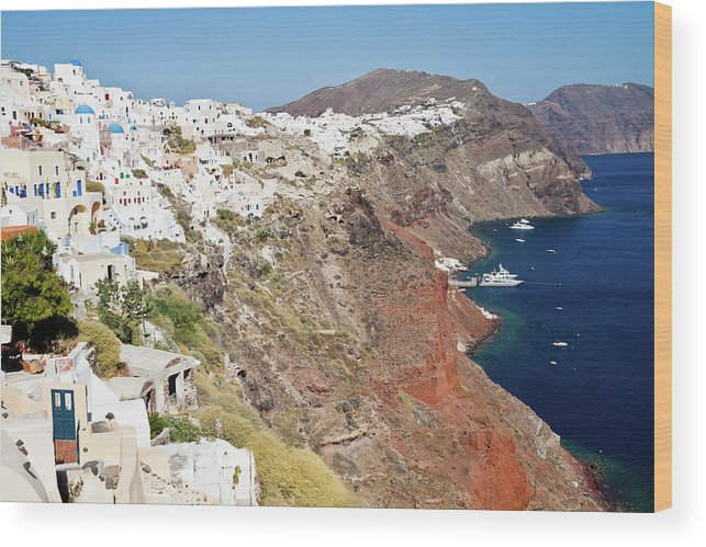 Tranquility Wood Print featuring the photograph Rows Of Houses Perch On Cliff In Oia by Melissa Tse