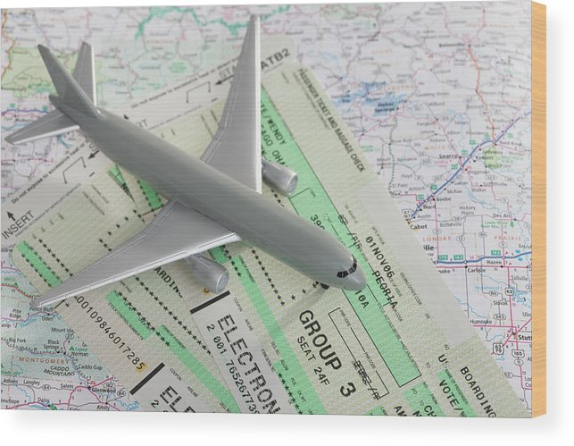 Airplane Wood Print featuring the photograph Studio Shot Of Toy Airplane With by Vstock Llc