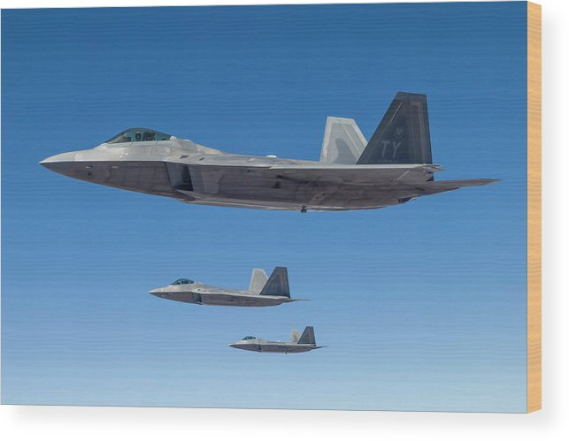 Formation Flying Wood Print featuring the photograph Three U.s. Air Force F-22 Raptors by Rob Edgcumbe/stocktrek Images