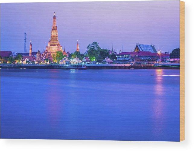 Scenics Wood Print featuring the photograph Wat Arun Temple Bangkok Thailand by Deimagine
