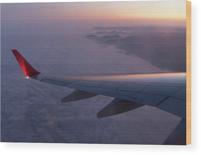 Taking Off Wood Print featuring the photograph Wing Of An Aeroplane With Sunset by Rotofrank
