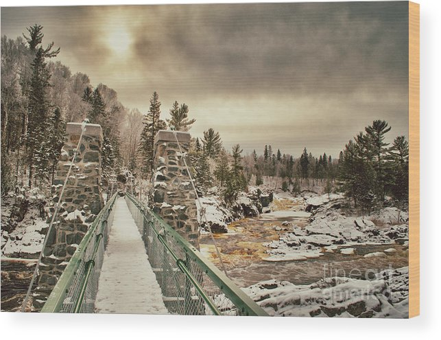 Jay Cooke Wood Print featuring the photograph Winter Sunrise Over A Swinging Bridge by Ever-Curious Photography