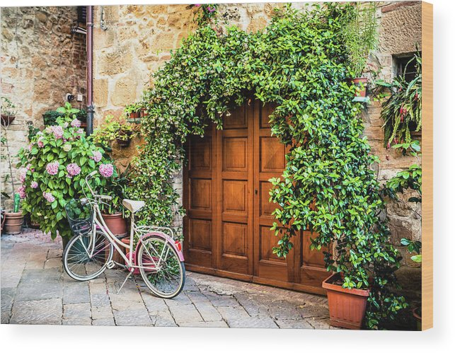 Val D'orcia Wood Print featuring the photograph Wooden Gate With Plants In An Ancient by Giorgiomagini