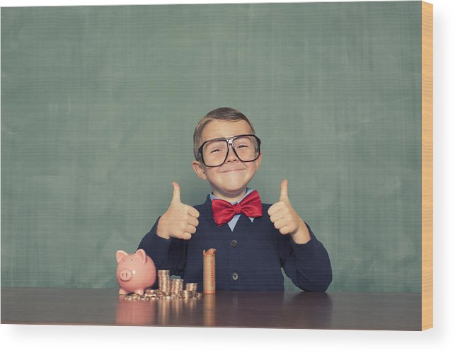 4-5 Years Wood Print featuring the photograph Young Boy Nerd Saves Money in His Piggy Bank by RichVintage