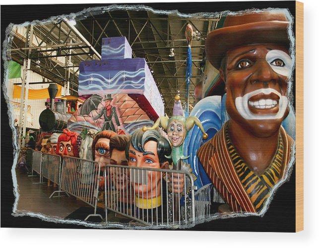 Mardi Gras World Wood Print featuring the photograph Barricade Heads by Linda Kish