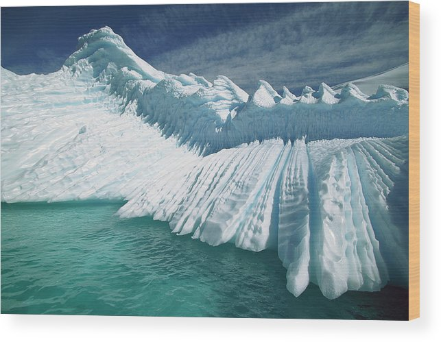 Hhh Wood Print featuring the photograph Overturned Iceberg With Eroded Edges by Colin Monteath