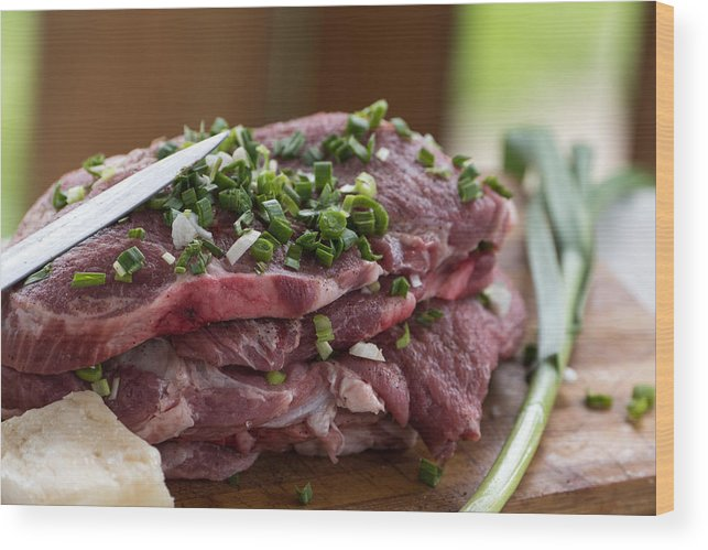 Background Wood Print featuring the photograph Pork meat with green garlik by Adrian Bud