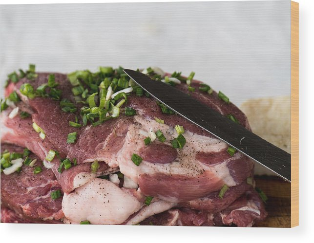 Background Wood Print featuring the photograph Pork meat with green garlik and knife by Adrian Bud