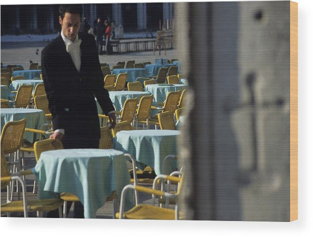 Venice Wood Print featuring the photograph Waiter Preparing for the day in Piazza San Marco in Venice by Michael Henderson