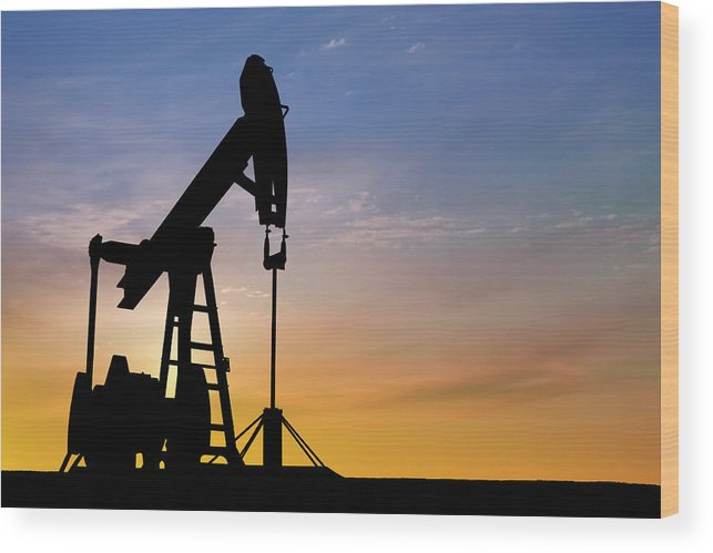 Dawn Wood Print featuring the photograph Dawn Over Petroleum Pumps In The Desert by Grafissimo