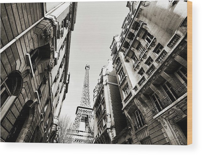 Built Structure Wood Print featuring the photograph Eiffel Tower Between Buildings In by Flory