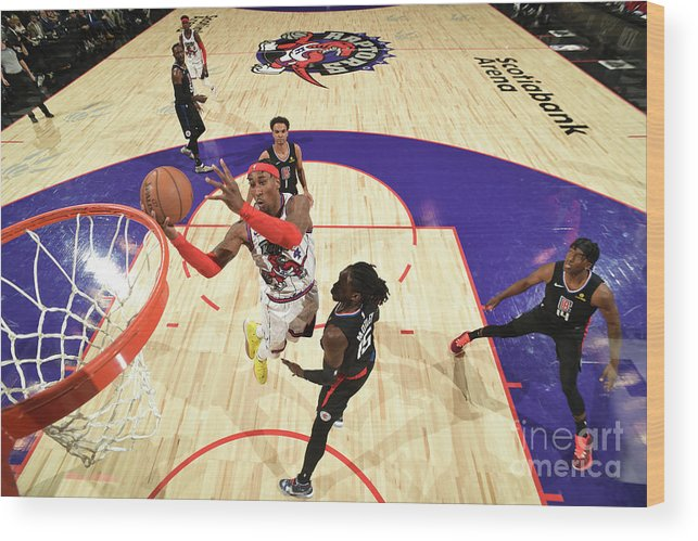 Nba Pro Basketball Wood Print featuring the photograph La Clippers V Toronto Raptors by Ron Turenne