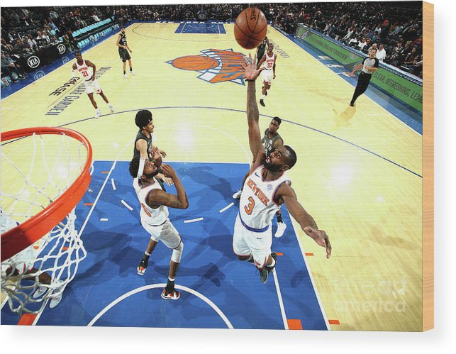 Tim Hardaway Jr. Wood Print featuring the photograph Brooklyn Nets V New York Knicks by Nathaniel S. Butler
