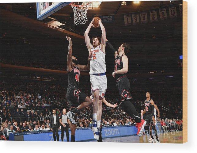 Nba Pro Basketball Wood Print featuring the photograph Chicago Bulls V New York Knicks by Jesse D. Garrabrant