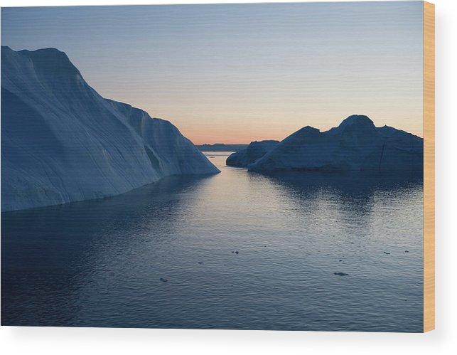Melting Wood Print featuring the photograph Icebergs Of Ilulissat Kangerlua by Holger Leue