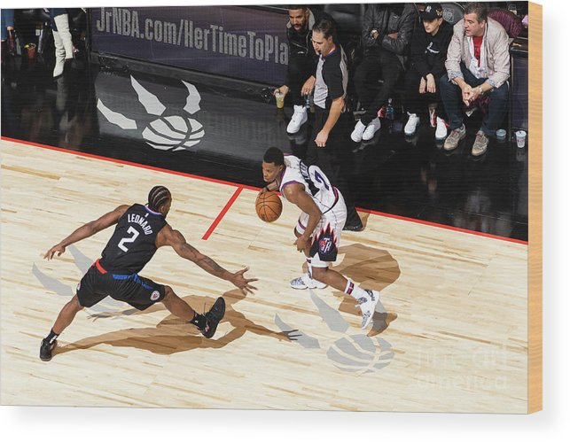 Nba Pro Basketball Wood Print featuring the photograph La Clippers V Toronto Raptors by Mark Blinch