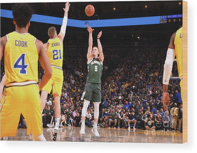 Nba Pro Basketball Wood Print featuring the photograph Milwaukee Bucks V Golden State Warriors by Noah Graham