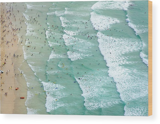 Water's Edge Wood Print featuring the photograph Swimmers And Surfers On Beach, Aerial by Jason Hawkes