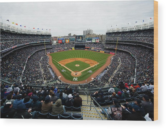 East Wood Print featuring the photograph Baltimore Orioles V. New York Yankees by Rob Tringali