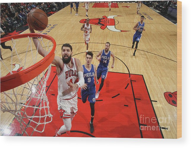Nba Pro Basketball Wood Print featuring the photograph Philadelphia 76ers V Chicago Bulls by Gary Dineen