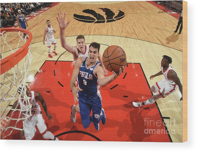 Nba Pro Basketball Wood Print featuring the photograph Philadelphia 76ers V Toronto Raptors by Ron Turenne