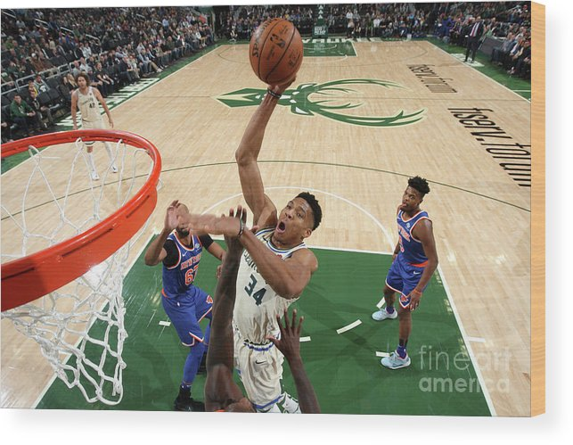 Nba Pro Basketball Wood Print featuring the photograph New York Knicks V Milwaukee Bucks by Gary Dineen