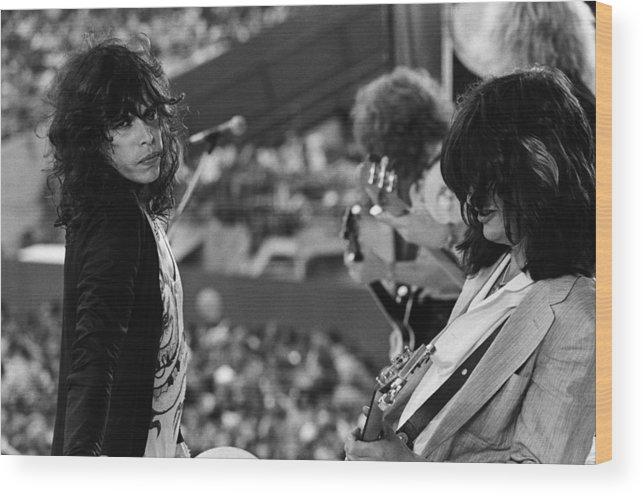 Tom Hamilton Wood Print featuring the photograph Aerosmith Performs Live by Richard Mccaffrey