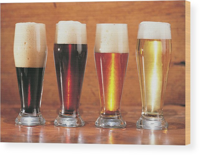 Stout Wood Print featuring the photograph Assorted Beers And Ales by Comstock