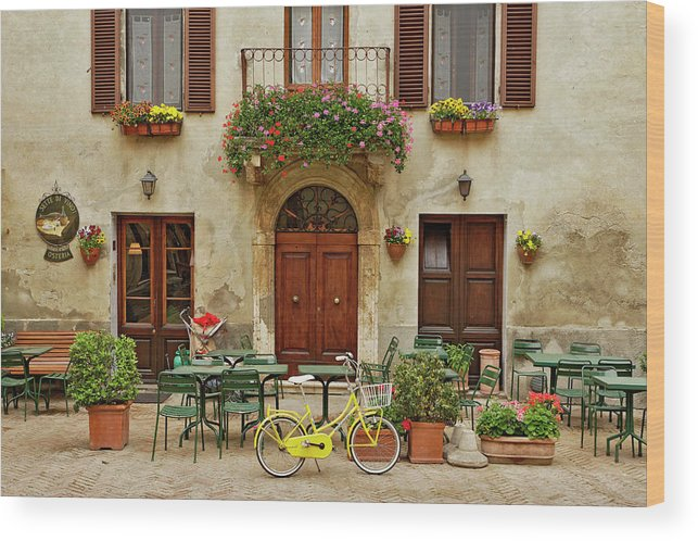 Pienza Wood Print featuring the photograph Bicycle In Front Of Small Cafe, Tuscany by Adam Jones