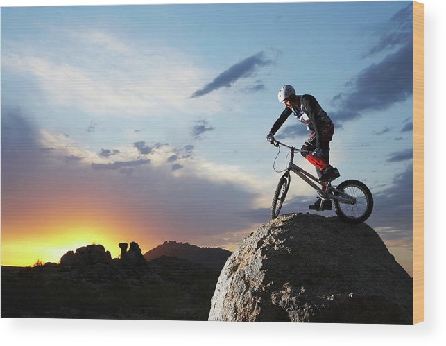 Sports Helmet Wood Print featuring the photograph Bike Rider Balancing On Rock Boulder by Thomas Northcut