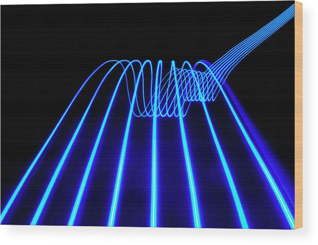Laser Wood Print featuring the photograph Blue Abstract Coloured Lights Trails by John Rensten