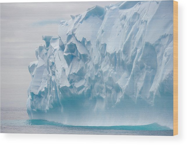Scenics Wood Print featuring the photograph Blue Iceberg Carved By Waves Floats In by Eastcott Momatiuk