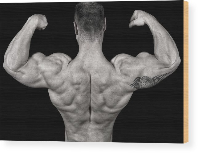 Toughness Wood Print featuring the photograph Bodybuilder Posing by Vuk8691