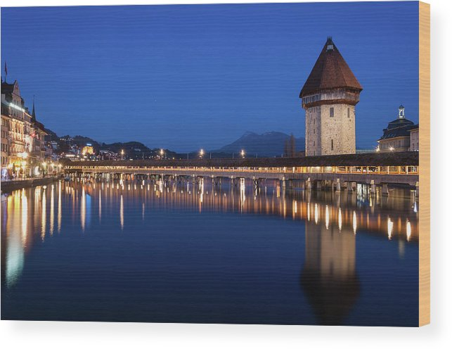 Clear Sky Wood Print featuring the photograph Chapel Bridge And Water Tower by Thant Zaw Wai