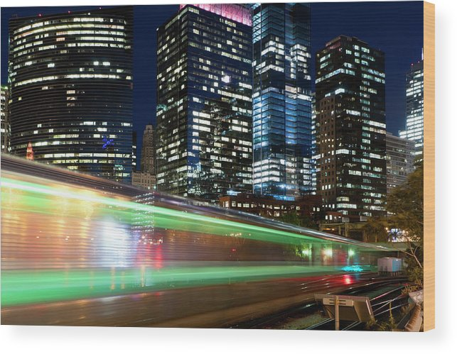 Passenger Train Wood Print featuring the photograph Commuter Train In Downtown Chicago by Chrisp0