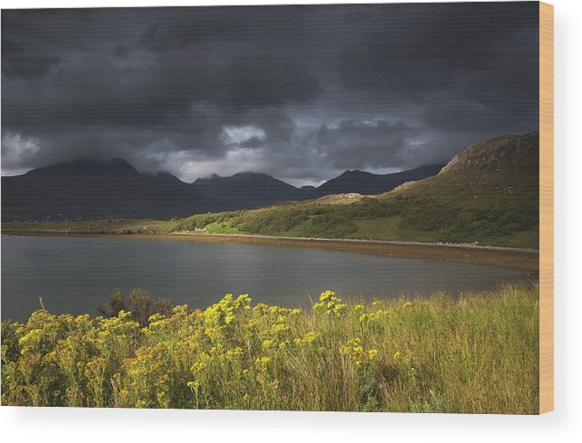 Tranquility Wood Print featuring the photograph Dark Storm Clouds Hang Over The by John Short / Design Pics
