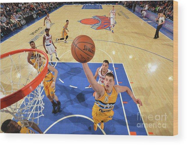 Nba Pro Basketball Wood Print featuring the photograph Denver Nuggets V New York Knicks by Jesse D. Garrabrant