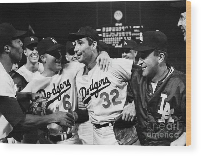 Sandy Koufax Wood Print featuring the photograph Dodgers Congratulating Sandy Koufax by Bettmann